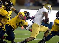 Michael Lowe of California tries to sack UCLA quarterback Brett Hundley during the game at Memorial Stadium in Berkeley, California on October 6th, 2012.  California defeated UCLA, 43-17.
