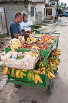 Finca La Vigia, San Francisco de Paula, Cuba; a street vendor sells fruits and vegetables from a cart outside the entrance to the Hemingway Museum