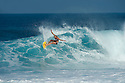 Unknown surfer at Off the wall on the Northshore of Oahu in Hawaii.
