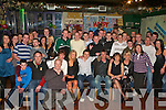 21ST BIRTHDAY BASH: John Payne, Ballyhar, Killarney (seated centre), celebrated his 21st birthday with his family and friends in Br. McCudda's Bar, Killarney, on Saturday night.   Copyright Kerry's Eye 2008