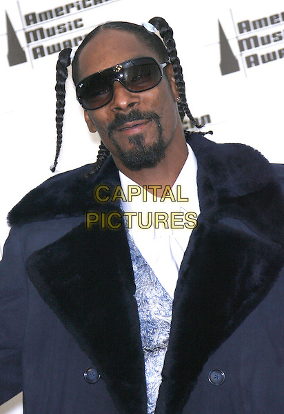 SNOOP DOGG.34th Annual American Music Awards - Press Room held at the Shrine Auditorium, Los Angeles, California, USA..November 21st, 2006.headshot portrait sunglasses shades braids plaits goatee.CAP/ADM/ZL.©Zach Lipp/AdMedia/Capital Pictures