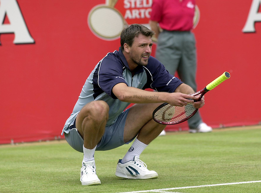 Photo:Ken Brown .11/06/2001. .Stella Artois Championship 2001 .Goran Ivanisevic down on his as he goes out th Cristiano Caratti.