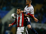 Billy Sharp of Sheffield Utd challenged by Mark Beevers of Bolton Wanderers during the Championship match at the Macron Stadium, Bolton. Picture date 12th September 2017. Picture credit should read: Simon Bellis/Sportimage