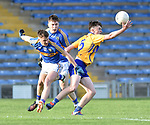 Conor Carrig of  Clare  in action against Christy English and Gavin Meagher of  Tipperary during their Munster Minor football semi-final at Thurles. Photograph by John Kelly.