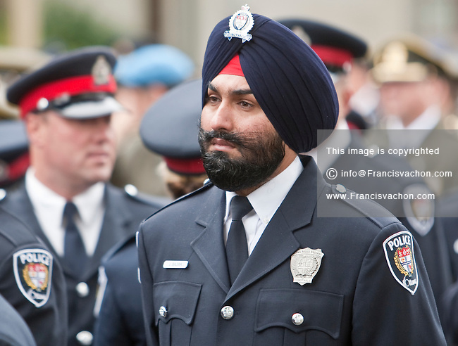 A member of the Ottawa police force wearing a sikh turban is seen in Ottawa Sunday September 26, 2010.