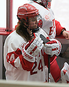 Taylor Holze (BU - 24) joined the bench from the penalty box during a timeout. - The Boston University Terriers defeated the visiting University of Connecticut Huskies 4-2 on Saturday, November 19, 2011, at Walter Brown Arena in Boston, Massachusetts.