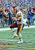Washington Redskins defensive tackle Darryl Grant (77) scores a touchdown on a 10 yard interception return in the fourth quarter of the National Football Conference (NFC) Championship Game against the Dallas Cowboys at RFK Stadium in Washington, D.C. on Saturday, January 22, 1983.    The Redskins won the game and the championship 31 - 17.<br /> Credit: Arnie Sachs / CNP