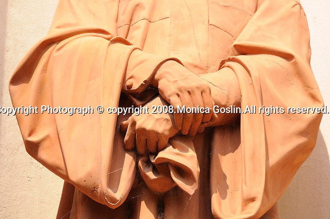 Detail of the hands of a statue on a church in Cernobbio, Italy on Lake Como.