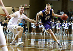 SIOUX FALLS, SD: Drew Guebert #23 from the University of Sioux Falls drives against Taylor Schafer #20 from Southwest Minnesota State in the first half of their NSIC Tournament game Sunday at the Sanford Pentagon (Photo by Dave Eggen/Inertia)