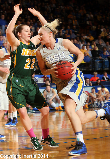 BROOKINGS, SD - FEBRUARY 22:  Mariah Clarin #40 from South Dakota State University drives against Bree Whatman #22 from North Dakota State University in the first half of their game Saturday afternoon at Frost Arena in Brookings.  (Photo by Dave Eggen/Inertia)