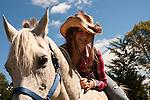A cowgirl on her Arabian Horse