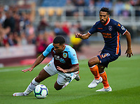 Burnley's Aaron Lennon is sent tumbling by Istanbul Basaksehir's Gael Clichy<br /> <br /> Photographer Alex Dodd/CameraSport<br /> <br /> UEFA Europa League - Third Qualifying Round 2nd Leg - Burnley v Istanbul Basaksehir - Thursday 16th August 2018 - Turf Moor - Burnley<br />  <br /> World Copyright © 2018 CameraSport. All rights reserved. 43 Linden Ave. Countesthorpe. Leicester. England. LE8 5PG - Tel: +44 (0) 116 277 4147 - admin@camerasport.com - www.camerasport.com