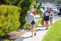 Incoming first-years and their families are welcomed by enthusiastic O-Team members and other members of the community during Occidental College's Fall move-in and orientation for the class of 2022, Aug. 23, 2018.<br /> (Photo by Marc Campos, Occidental College Photographer)