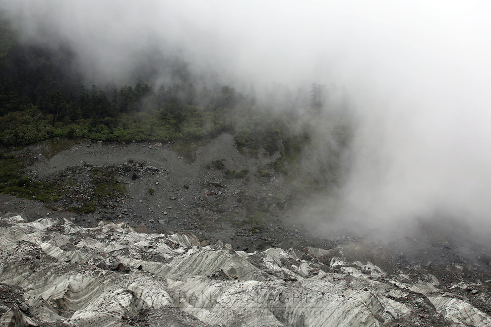 Clouds roll in over the Hailuogou glacier. Even at a relatively low altitudes of between 3,200-4,800 meters above sea level, the weather can change in a matter of minutes. As a result of rising temperatures on the Tibetan Plateau, the Hailuogou glacier has retreated over 2 km during the 20th century alone. Since the Little Ice Age, studies have revealed that the total monsoonal glacier coverage in the southeast of the Tibetan Plateau has decreased by as much as 30 percent, causing alarm in scientific circles.