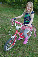 Young Polish girl age 6 on her decorated fancy bicycle. Zawady Central Poland