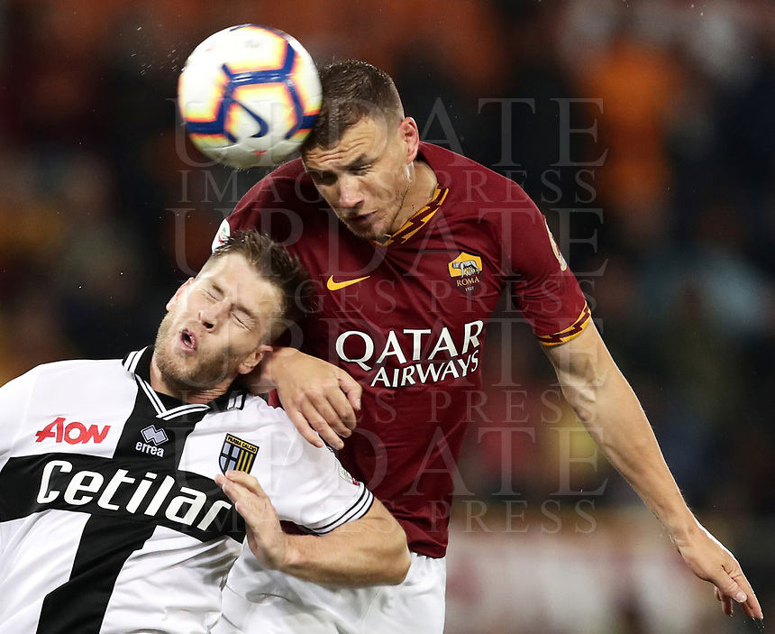 Football, Serie A: AS Roma - Parma, Olympic stadium, Rome, May 26, 2019. <br /> Roma's Edin Dzeko (r) in action with Parma's Riccardo Gagliolo (l) during the Italian Serie A football match between Roma and Parma at Olympic stadium in Rome, on May 26, 2019.<br /> UPDATE IMAGES PRESS/Isabella Bonotto