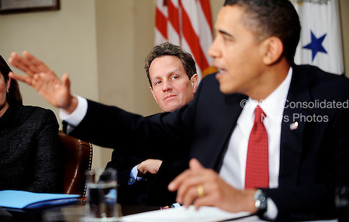 Washington, DC - December 22, 2009 -- United States Secretary of the Treasury Timothy Geithner looks on as U.S. President Barack Obama speaks during a meeting with CEOs of several small and community banks in the Roosevelt Room at the White House, in Washington, DC, on Tuesday, December 22, 2009..Credit: Olivier Douliery / Pool via CNP