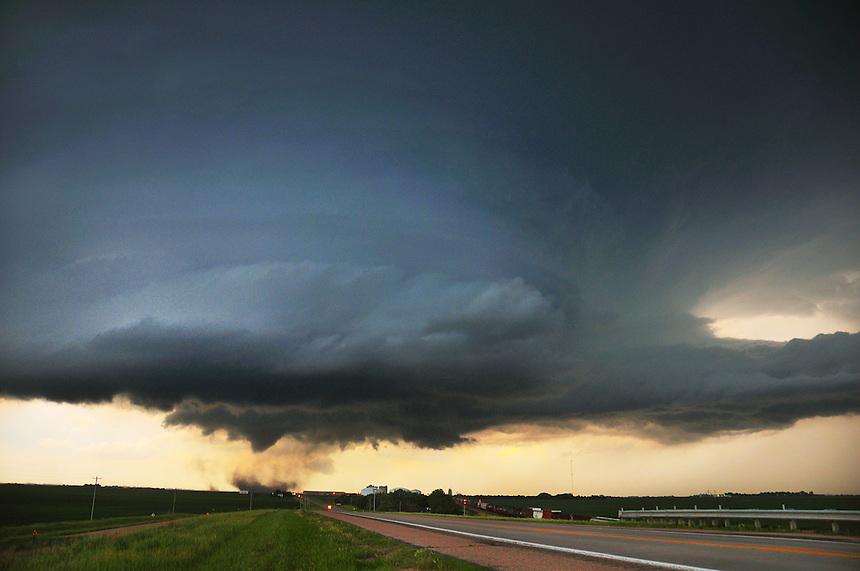 A destructive tornado rapidly develops as a supercell thunderstorm approaches Aurora Nebraska on June 17th, 2009.