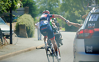 in a very hot stage the job of the water carrier/domestique can not be overstated<br /> J&eacute;rome Pinaut (FRA/IAM) on duty here<br /> <br /> 2014 Tour de France<br /> stage 12: Bourg-en-Bresse - Saint-Eti&egrave;nne (185km)