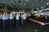 United States Secretary of Defense Donald H. Rumsfeld reads the oath of enlistment to eighty-five service members during a reenlistment ceremony aboard the USS John F. Kennedy (CV 67) on October 9, 2004.  Rumsfeld is onboard the aircraft carrier to meet with crew members and host coalition ministers of defense. <br /> Mandatory Credit: James M. Bowman / DoD via CNP