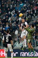 6th January 2020; Allianz Stadium, Turin, Italy; Serie A Football, Juventus versus Cagliari; Merih Demiral of Juventus wins a header over Alberto Cerri of Cagliari - Editorial Use