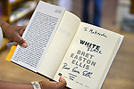 CORAL GABLES, FL - APRIL 19: General view of a fan holding a signed copy of author and screenwriter Bret Easton Ellis' book with the word 'white' crossed and replaced with 'black' during a book signing of Bret's new book 'WHITE' at Books & Books on April 19, 2019 in Coral Gables, Florida.( Photo by Johnny Louis / jlnphotography.com )