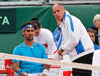 Corrado Barazzutti talks with Fabio Fognini during Davis Cup quarter-final tennis match against James Ward in Naples April 4, 2014.