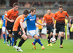 Dundee United v St Johnstone...24.08.13      SPFL<br /> Stevie May is closed down by Keith Watson, Paul Paton and <br /> Picture by Graeme Hart.<br /> Copyright Perthshire Picture Agency<br /> Tel: 01738 623350  Mobile: 07990 594431