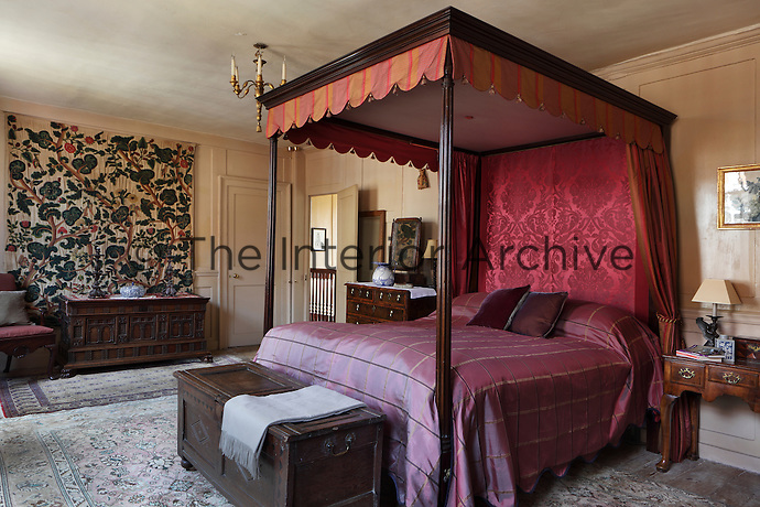 A four-poster bed dressed with crimson damask bed hangings made by Eleanor herself. The end posts were bought from one of Eleanor's friends and then she had the rest constructed around them