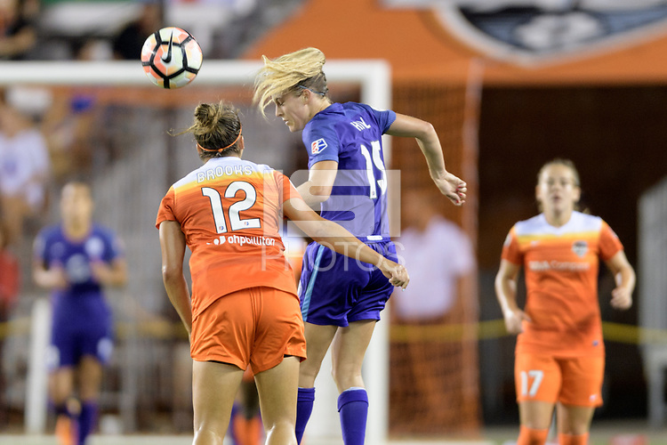 Houston, TX - Saturday June 17, 2017: Rachel Hill heads the ball away from Amber Brooks  during a regular season National Women's Soccer League (NWSL) match between the Houston Dash and the Orlando Pride at BBVA Compass Stadium.