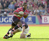 Photo Peter Spurrier.12/10/2002.Heineken European Cup Rugby.Gloucester vs Munster - Kingsholm.Bloucester wing, Marcel Garvey.