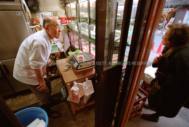 3/5/2002--Tokyo, Japan..Minoru Fukuda, 60, who with his wife Tomiko, run Fukudaya, a fish shop on Hiro-o's main shopping street. Faced with tough economic conditions, such traditional family-run shops in Japan are facing difficult times...All photographs ©2003 Stuart Isett.All rights reserved.This image may not be reproduced without expressed written permission from Stuart Isett.