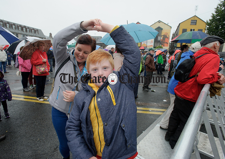 Doonbeg's Ethan Morrissey dancing with his mother Sandra  in Abbey Street car Park during a wet final Sunday of the All-Ireland Fleadh in Ennis. Photograph by John Kelly.