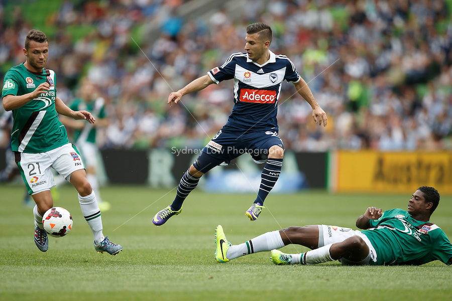 Kosta BARBAROUSES of the Victory and Kew JALIENS of the Jets compete for the ball in the round nine match between Melbourne Victory and the Newcastle Jets in the Australian Hyundai A-League 2013-24 season at AAMI Park, Melbourne, Australia. Photo Sydney Low/Zumapress<br /> <br /> This image is not for sale on this web site. Please visit zumapress.com for licensing