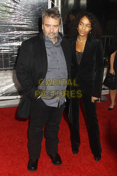 "LUC BESSON & GUEST .At the ""From Paris with Love"" New York Premiere held at the Ziegfeld Theatre, New York, NY, USA, 28th January 2010..full length black coat grey gray shirt suit trousers trousers jacket hand on pocket .CAP/ADM/AC.©Alex Cole/Admedia/Capital Pictures"