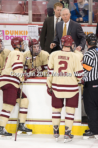Isaac MacLeod (BC - 7), Edwin Shea (BC - 8), Greg Brown (BC - Assistant Coach), Jerry York (BC - Head Coach), Brian Dumoulin (BC - 2) - The Boston College Eagles defeated the visiting University of New Hampshire Wildcats 4-3 on Friday, January 27, 2012, in the first game of a back-to-back home and home at Kelley Rink/Conte Forum in Chestnut Hill, Massachusetts.