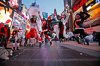 People dressed in merry christmas characters jump up for a picture as they take part at the Santacon's Annual Festival at Times Square in New York, United States. 14/12/2012. Photo by ZAMEK