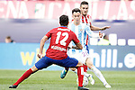 Atletico de Madrid's Augusto Fernandez (b) and Koke Resurrecccion (r) and Malaga CF's Juanpi Anor during La Liga match. April 23,2016. (ALTERPHOTOS/Acero)