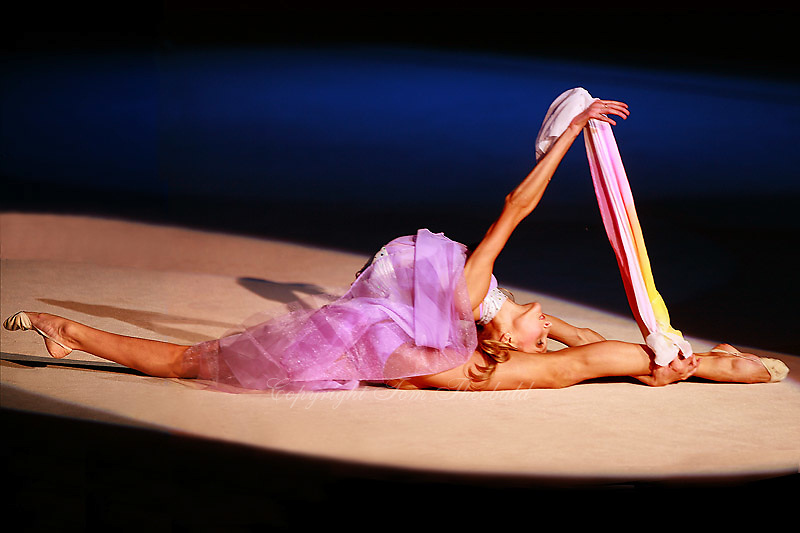 Maryia Yushkevich of Belarus flexibility to finish handsfree  gala exhibition in chiffon at 2006 Portimao World Cup of Rhythmic Gymnastics on September 10, 2006 at Portimao, Portugal.  (Photo by Tom Theobald)<br />