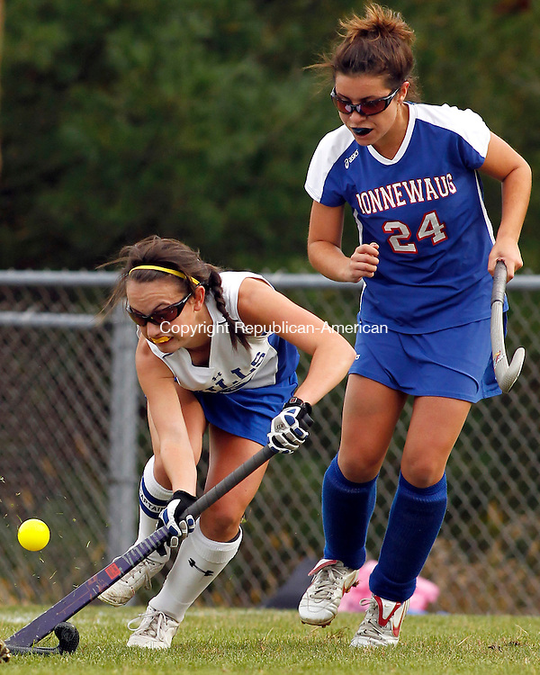 Burlington, CT- 18, October 2010-101810CM01  Lewis Mills Megan Osanitsch works the ball upfield as Nonnewaug's Sarah DeRosa (right) tries to defend during Berkshire Field Hockey action Monday afternoon in Burlington.  Nonnewaug blanked Mills 3-0, remaining undefeated on the season.  Christopher Massa Republican-American