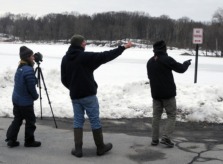 Bird watch hers gathering at the Saugerties  Beach before starting the Steve Chorvas led Esopus Creek Conservancy's Annual Spring Bird Walk, along the Saugerties Lighthouse Trail, in Saugerties, NY on Sunday, March 19, 2017. Photo by Jim Peppler. Copyright Jim Peppler 2017.
