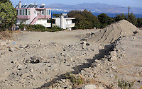 Pictured: Mounts of rubble left at the second site where a search took place in Kos, Greece. Monday 17 October 2016<br />