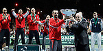 Serbia's team captain Bogdan Obradovic receive trophy from ITF President Francesko Ricci Biti, Serbia won Davis Cup finals against France in Belgrade, Serbia, Sunday, Dec. 5, 2010..(Srdjan Stevanovic/Starsportphoto ©)
