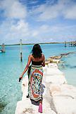 EXUMA, Bahamas. A local women along the shore of Staniel Cay.
