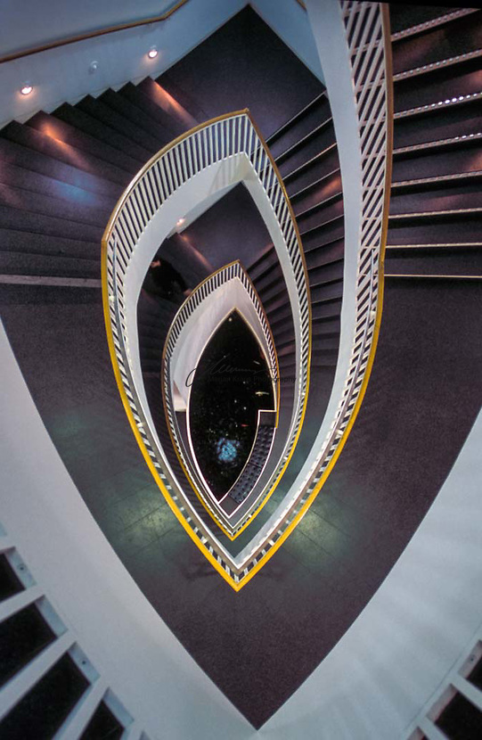 The distinct staircase designed by Josef Paul Kleihues. The Museum of Contemporary Art (MCA) Chicago is a contemporary art museum near Water Tower Place in downtown Chicago in Cook County, Illinois, United States. The museum, which was established in 1967, is one of the world's largest contemporary art venues. The museum's collection is composed of thousands of objects of Post-World War II visual art.<br /> <br /> The museum has hosted several notable debut exhibitions including Frida Kahlo's first U.S. exhibition and Jeff Koons' first solo museum exhibition. Koons later presented an exhibit at the Museum that established the museum's current attendance record for an exhibition. Its collection, which includes Jasper Johns, Andy Warhol, Cindy Sherman, Kara Walker, and Alexander Calder, contains historical samples of 1940s&ndash;1970s late surrealism, pop art, minimalism, and conceptual art; notable holdings 1980s postmodernism; as well as contemporary painting, sculpture, photography, video, installation, and related media. The museum also presents dance, theater, music, and multidisciplinary arts.<br /> <br /> The current location at 220 East Chicago Avenue is in the Streeterville neighborhood of the Near North Side community area. Josef Paul Kleihues designed the current building after the museum conducted a 12-month search, reviewing more than 200 nominations. The museum opened at its new location June 21&ndash;22, 1996, with a 24-hour event that drew more than 25,000 visitors. The museum was originally located at 237 East Ontario Street, which was originally designed as a bakery. The building is known for its signature staircase leading to an elevated ground floor, which has an atrium, the full glass-walled east and west fa&ccedil;ades giving a direct view of the city and Lake Michigan.
