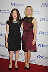 BEVERLY HILLS, CA- OCTOBER 23: Actress Sienna Miller (L) and International Corps President & CEO Nancy Aossey arrive at the International Medical Corps' Annual Awards dinner ceremony at the Beverly Wilshire Four Seasons Hotel on October 23, 2014 in Beverly Hills, California.