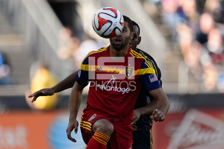 Alvaro Saborio (15) of Real Salt Lake plays the ball in front of Amobi Okugo (14) of the Philadelphia Union. Real Salt Lake and the Philadelphia Union played to a 2-2 tie during a Major League Soccer (MLS) match at PPL Park in Chester, PA, on April 12, 2014.