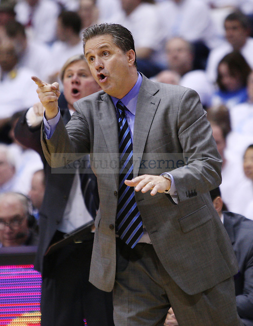 Kentucky Wildcats head coach John Calipari yells at a player during the UK men's basketball vs. North Carolina at the Dean Smith Center in Chapel Hill, N.C., on Saturday, December 14, 2013. Photo by Emily Wuetcher | Staff