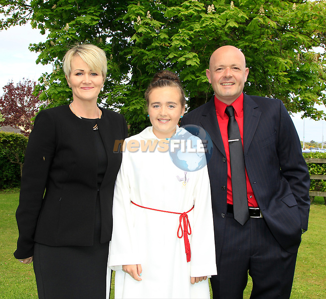 Sharon and Colum with Kelly Clifford during Confirmation for Scoil Sporaid Naoimh Laytown on Thursday 21st May 2015.<br /> Picture:  Thos Caffrey / www.newsfile.ie
