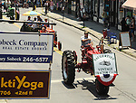 Procession of elements of the Saugerties Vintage Tractor Club on Partition Street in the Annual July 4th Parade in Saugerties, NY, on Wednesday, June 4, 2012. Photograph taken by Jim Peppler. Copyright Jim Peppler/2012